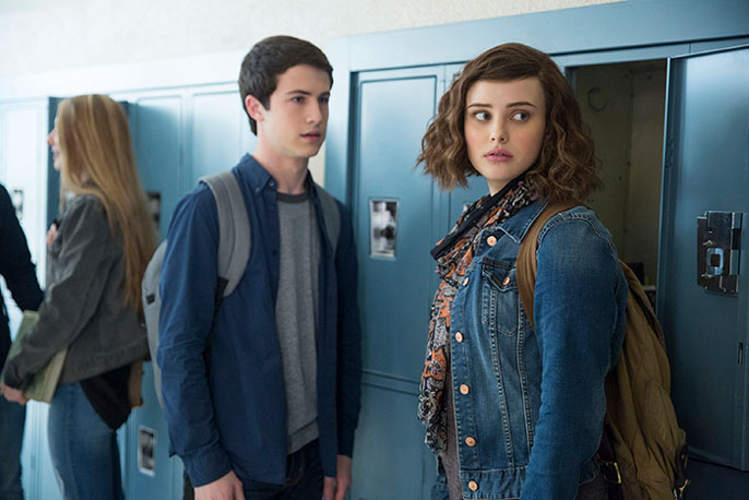 Two teens stand in front of locker in 13 Reasons Why