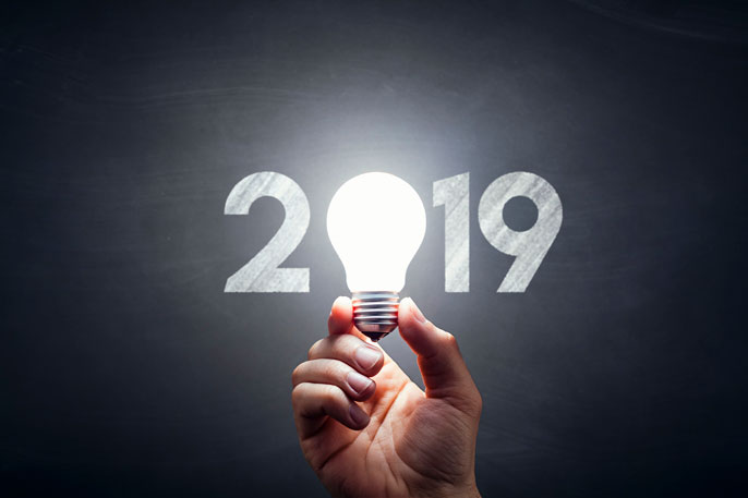 2019 graphic with someone holding a lightbulb