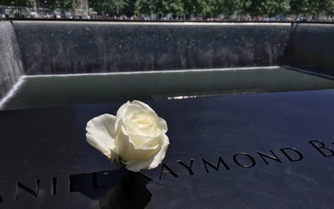 9/11 memorial with a white rose
