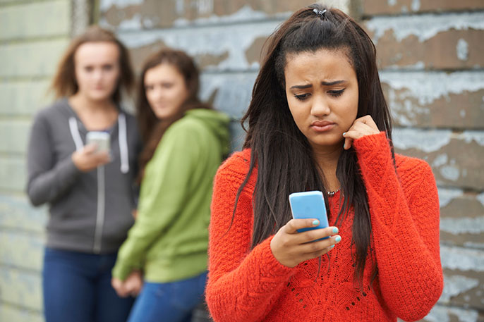 Online bullying: Why don't people intervene? | University of ...