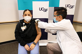 UCSF employee Reina Lopez being vaccinated against COVID-19