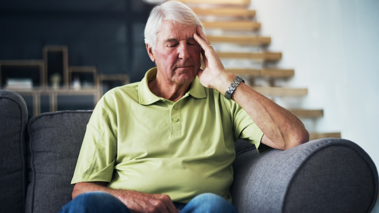 Older man coping with anxiety