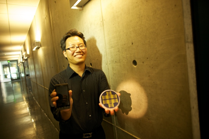 researcher holding prototypes