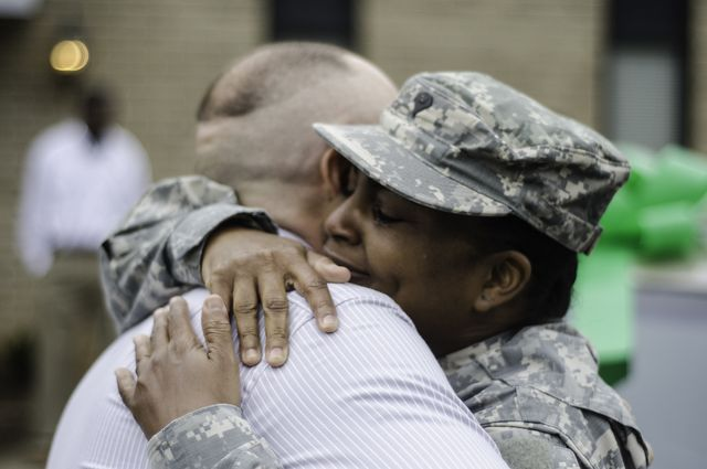 A member of the Georgia National Guard being hugged