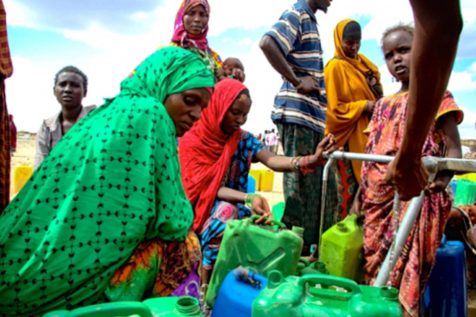 In the aftermath of an intense El Nino-induced drought, people gather around an Oxfam provided water tank in Hariso, Ethiopia.