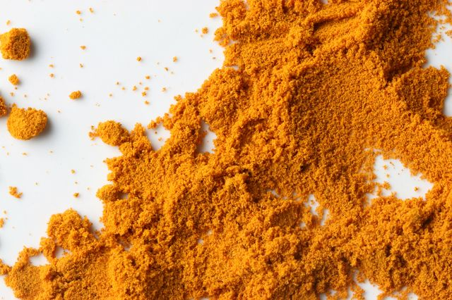 Powdered tumeric, the spice that contains curcumin.