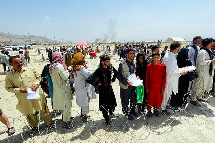 People gathered outside the airport in Kabul