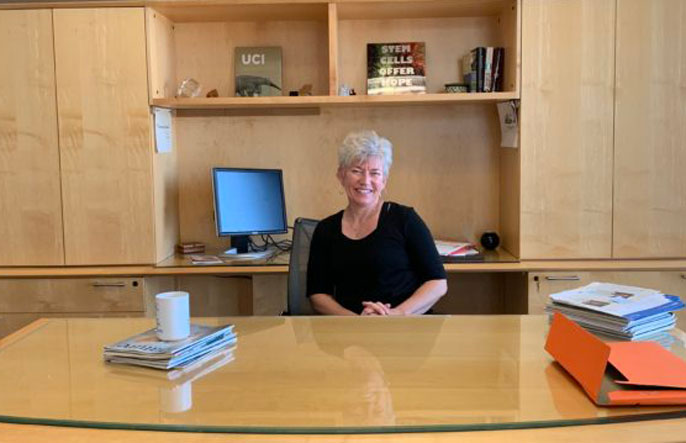 Aileen Anderson at her desk