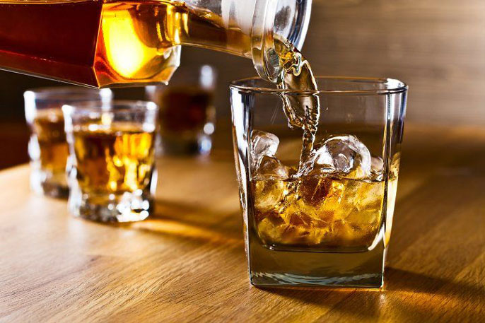 Whisky poured into a glass
