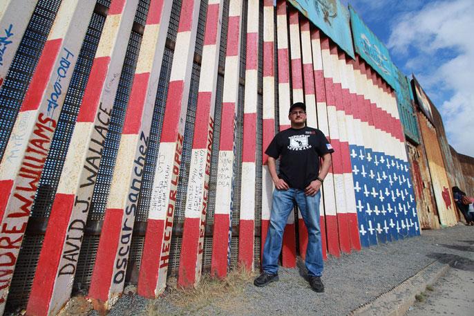 Alfredo Figueroa at the border wall