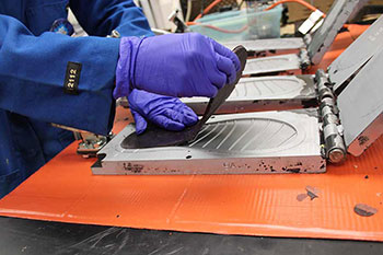 Foot-bed of flip-flops being pulled from a mold