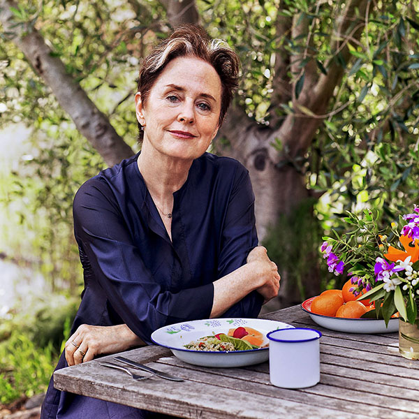 Alice Waters at a table
