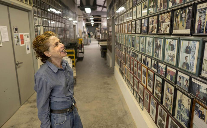 Annabeth Rosen looks at a wall of pictures