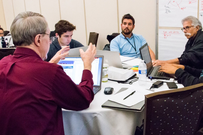 Winning team, Ag for Hire, brainstorms its app at the Apps for Ag Hackathon with the UC Davis World Food Center.