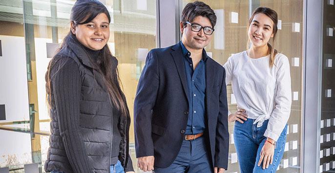 Professor Arif, center, with graduate students Laxmi Pandey, left, and Gulnar Rakhmetulla