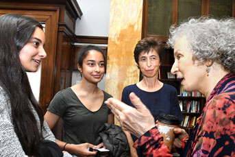 Margaret Atwood talks with students at a reception