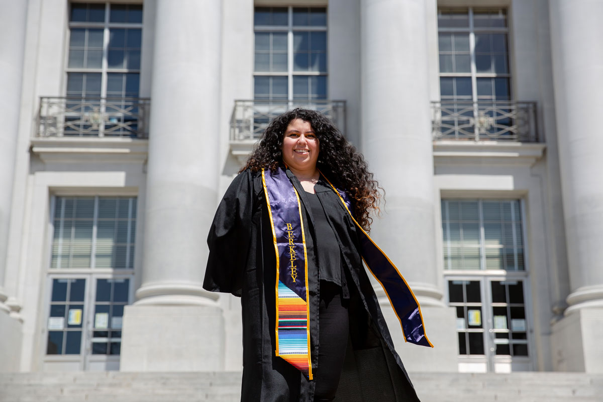 Aurora Lopez in cap and gown in front of Sproul at UC Berkeley