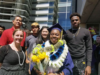 Banks celebrates her graduation with family