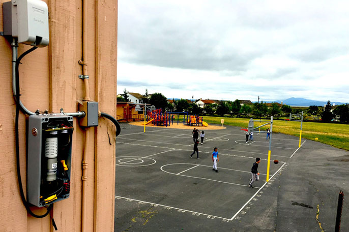 BEACON sensor near a playground basketball court