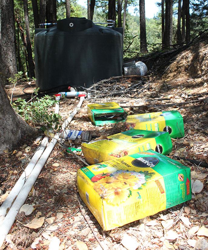 fertilizer boxes at marijuana grow site