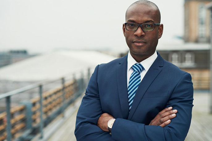 Young Black professional in blue suit