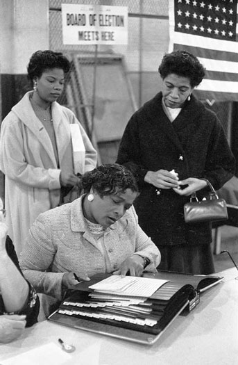 Three black women at a polling place in the 1960s
