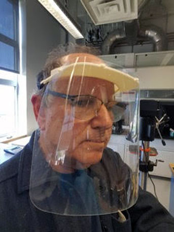David Bothman wears a face shield his lab created