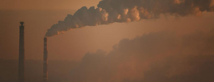 A smokestack plant emitting CO2