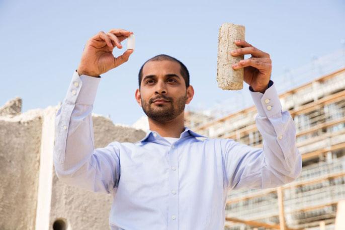 Gaurav Sant holding samples of concrete