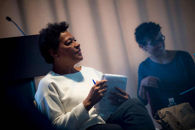 Carrie Mae Weems holds a notepad