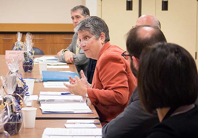 Janet Napolitano and community college officials
