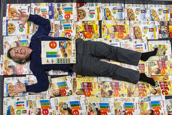Professor lying on top of cereal boxes
