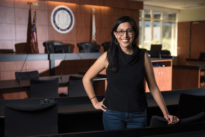Viridiana Chabolla stands in a courtroom, smiles