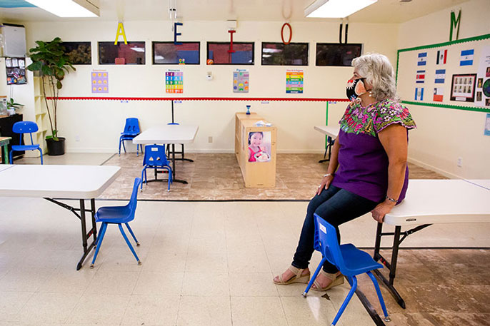 Beatriz Leyva-Cutler, executive director of Bay Area Hispano Institute for Advancement Inc. (BAHIA), sits in an empty classroom