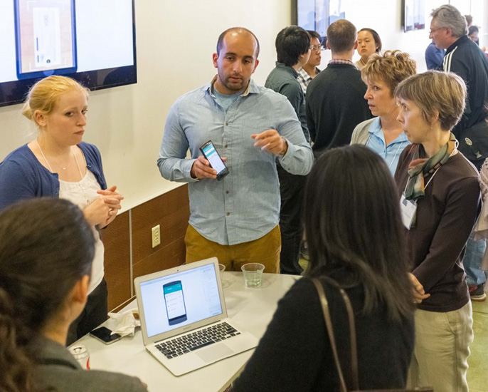 Members of Snapily explain their app at the CITRIS Mobile App Challenge at UC Berkeley.