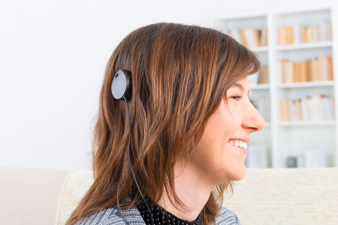 Woman with a cochlear implant