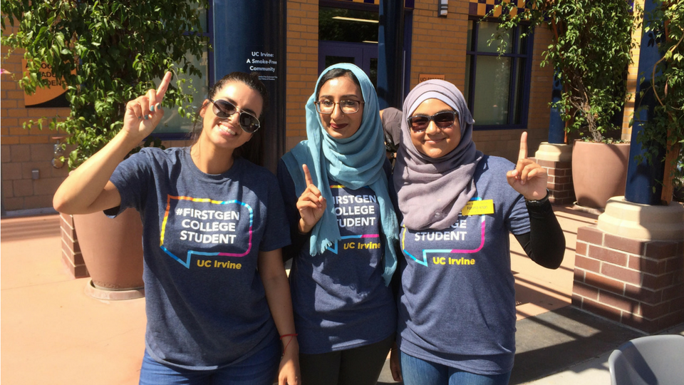 First-gen students pose for picture in first-gen T-shirts