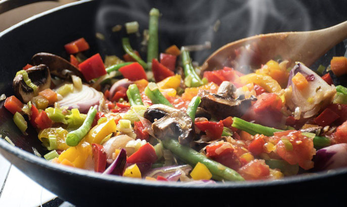 Vegetables being cooked in a pan