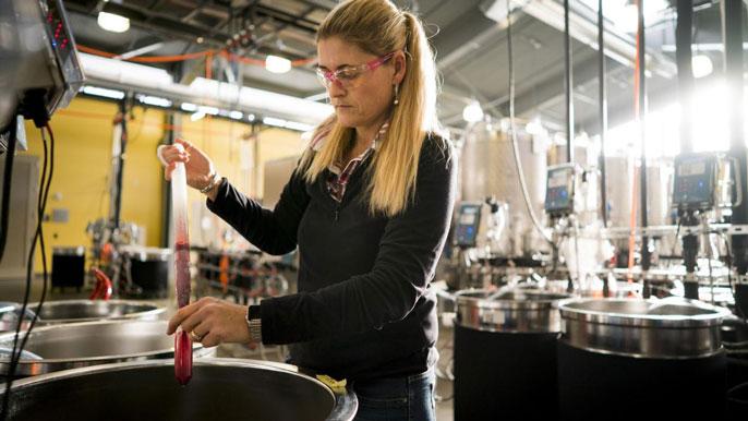 Woman analyzing wine contaminated with smoke