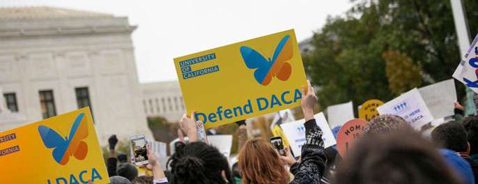 People holding up DACA signs outside SCOTUS