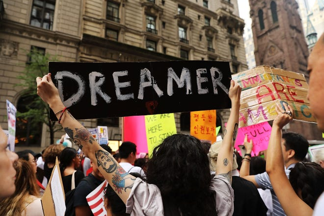 Dreamer supporters holding up signs at a rally