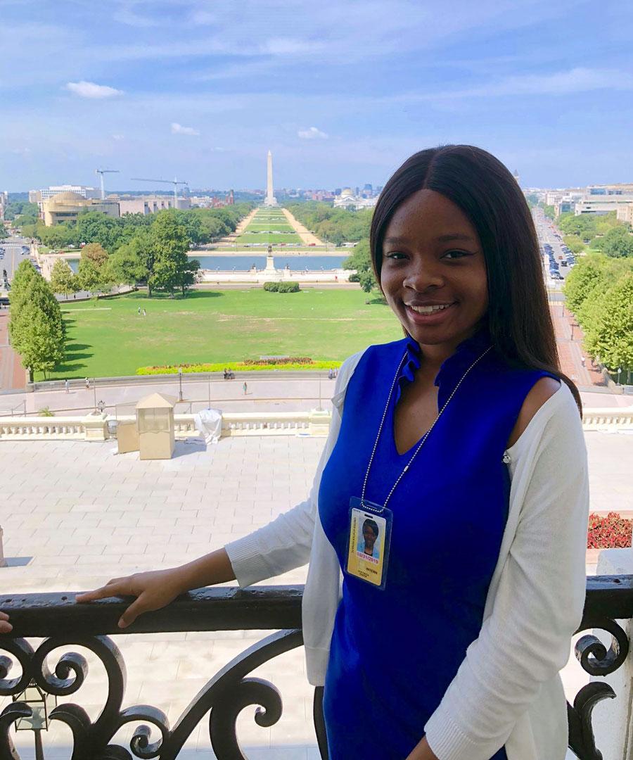 Ebelechuckwu Esek in Washington D.C., Washington Monument behind her