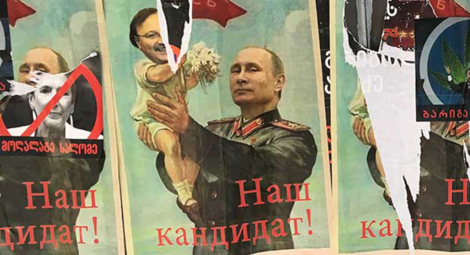 Election posters featuring Putin