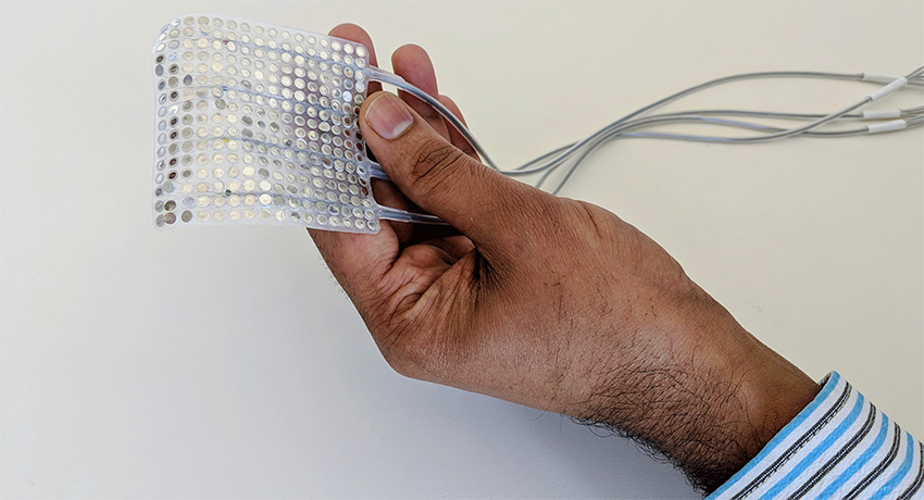 Hand holding the intracranial electrodes of the type used to record brain activity.