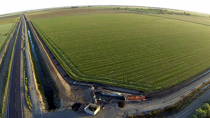 The upcoming climate-smart ag seminar will include discussions of California's elaborate water-delivery system, part of which is depicted in this photo of a Merced County field with its water pumps and adjacent irrigation canal.