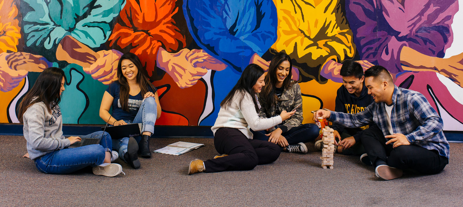 People at an Asian Pacific Cultural Center play games