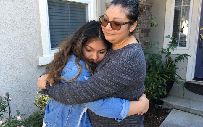 Garcia family in a hug