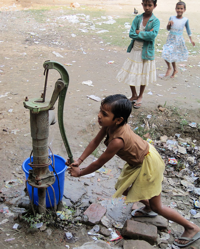 girl at water pump
