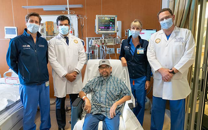 Gomez Gil in hospital with UC San Diego Health team