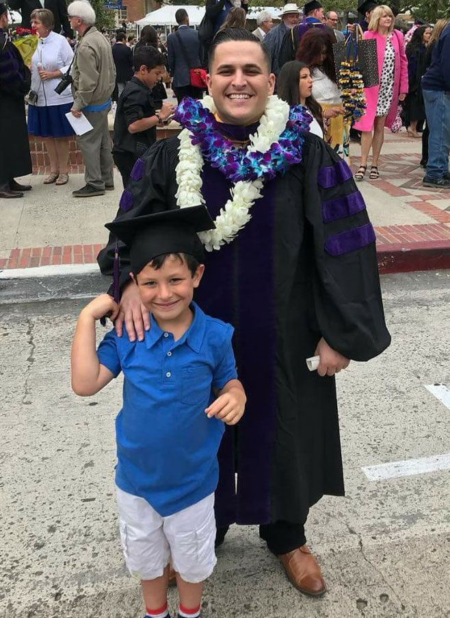 Goncalves with his son at graduation
